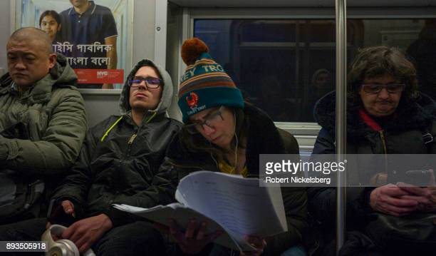 Passengers travel on the subway in New York City New York December 7 2017 The New York subway system faces a deteriorating infrastructure with...