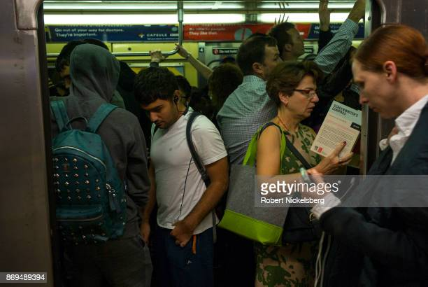 Passengers travel on the subway in New York City New York October 23 2017 The New York subway system faces a deteriorating infrastructure with...