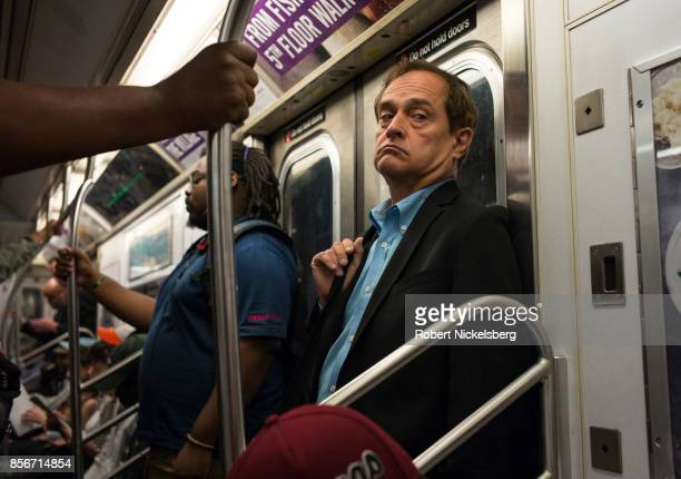 Passengers travel on the subway in New York City, New York, September 28, 2017. The New York subway averages 5.7 million daily rides.