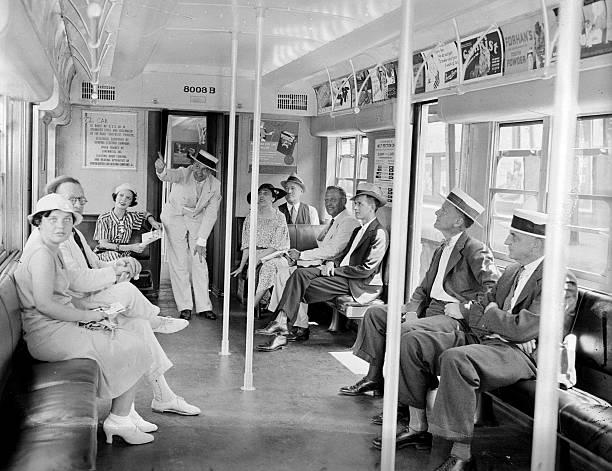 Passengers traveling from Brooklyn to Manhattan on mass tran