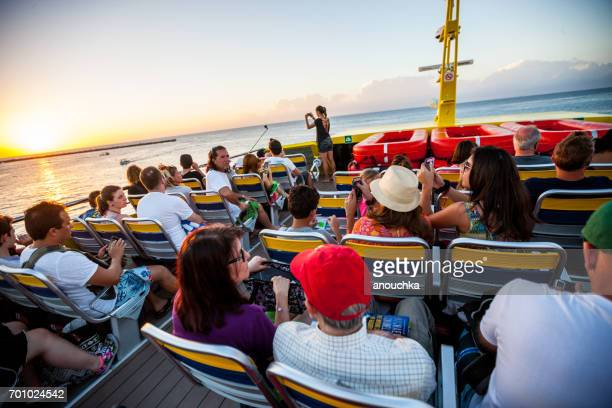 Passengers traveling on a ferry from Cozumel Island to Playa del Carmen, Mexico