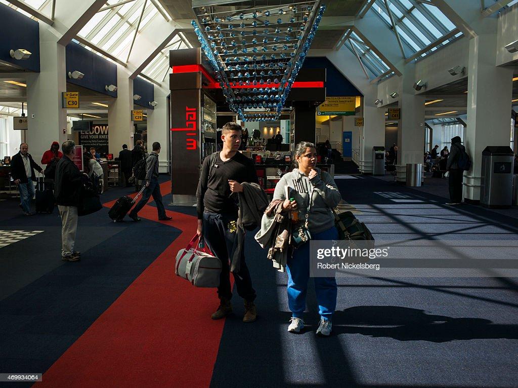 US Airways Passengers At New York's LaGuardia Airport : News Photo