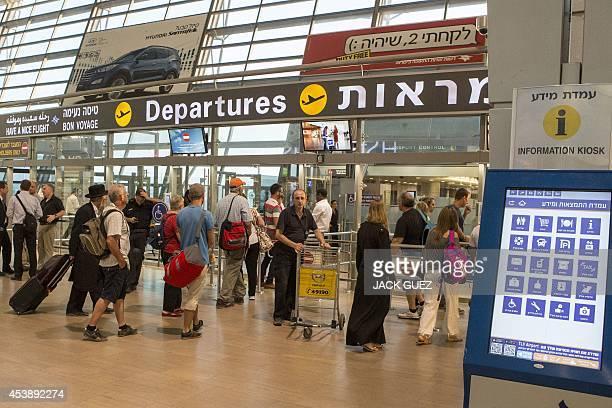 Passengers undergo security check at Ben Gurion International airport near the Mediterranean Israeli coastal city of Tel Aviv on August 21 following...