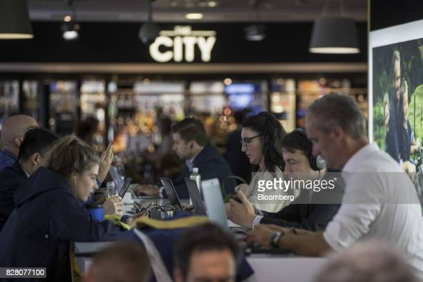 Passengers use computers and smartphones as they wait for departure inside London City Airport in London UK on Tuesday Aug 8 2017 The chief Brexit...