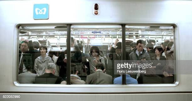 Passengers Using Mobile Phones on Tokyo Subway