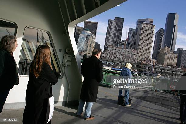 Passengers view the skyline of Seattle as they arrive from Bainbridge Island on a Washington State Ferry December 14 2005 at Seattle Pier 52 in...
