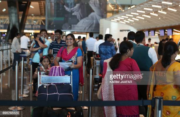 Passengers wai to checkin at a Qatar Airways counter in the Hamad International Airport in the Qatari capital Doha on June 12 2017 Qatar Airways...