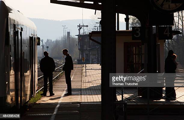Passengers waint on the platform of train station bad Salzungen next to a regional train on April 18 2008 in Bad Salzungen Germany