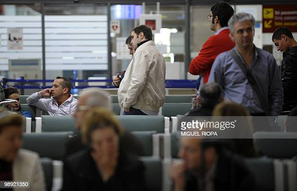 Passengers wait after their flights were cancelled from the Peinador airport in Vigo northwestern Spain on May 8 2010 Fifteen airports in northern...