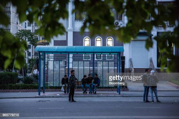 Passengers wait at a bus stop in Dushanbe Tajikistan on Saturday April 21 2018 Flung into independence after the Soviet Union collapsed in 1991 the...