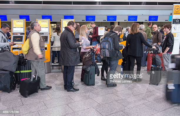 passengers wait at a Lufhansa Counter at the terminal 1 at Frankfurt International Airport during a strike by Lufthansa pilots on December 1 2014 in...