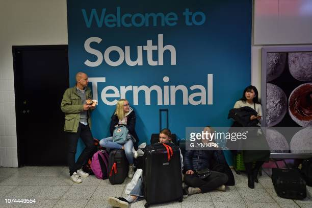 Passengers wait at London Gatwick Airport south of London on December 20 2018 after all flights were grounded due to drones flying over the airfield...