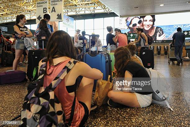 Passengers wait at Malpensa airport on June 20 2013 in Milan Italy Malpensa is one of the main international European airports with almost 20 milion...