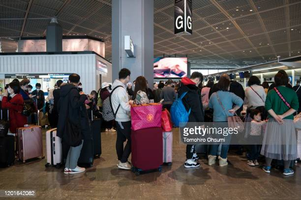 Passengers wait at Narita airport on January 24, 2020 in Narita, Japan. While Japan is one of the most popular foreign travel destinations for...