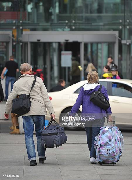 Passengers wait at the Berlin Hauptbahnhof in Germany, on May 20, 2015. German rail travel was paralysed Wednesday by an open-ended strike, It is the...