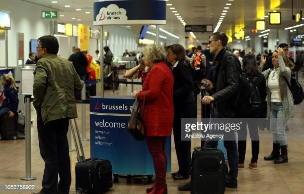 Passengers wait at the Brussels airport as the baggage handlers strike to protest working conditions in Brussels Belgium on October 26 2018
