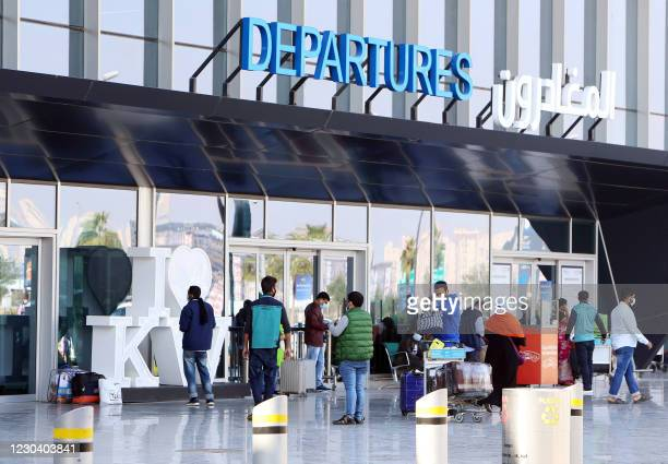 Passengers wait at the departure gate at Kuwait international airport in Kuwait City on January 3 as the country reopens the airport after a 12-day...