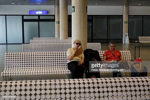 Passengers wait at the embarkment area for the the first commercial flight taking off at Castellon airport on September 15 2015 near Castellon de la...