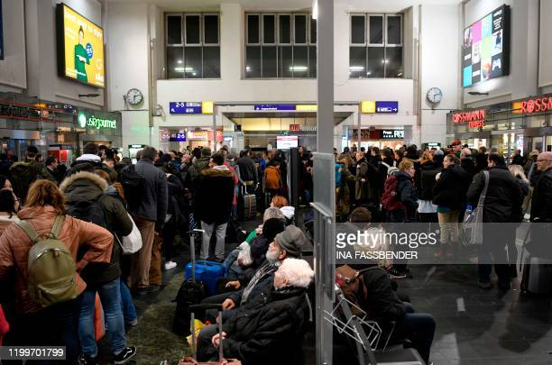 Passengers wait at the main railway station because of the forecasted heavy storm 'Sabine' in Dortmund western Germany on February 9 2020 Germany...