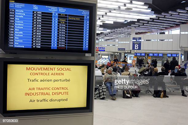 Passengers wait beside a screen announcing an air traffic control dispute on February 23 2010 at Paris' Orly airport Several flights were canceled or...