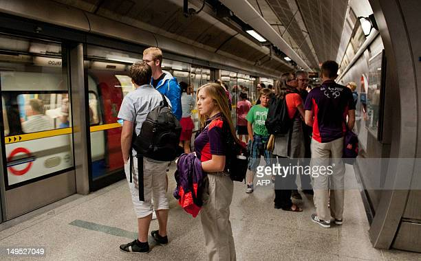 Passengers wait for a London underground train at London Bridge Station on July 30 on the first weekday after the start of the London 2012 Olympic...