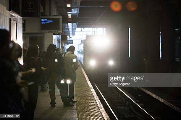 Passengers wait for an arriving train to New York Penn Station at the Secaucus Junction train station September 30 2016 in Secaucus New Jersey Over...