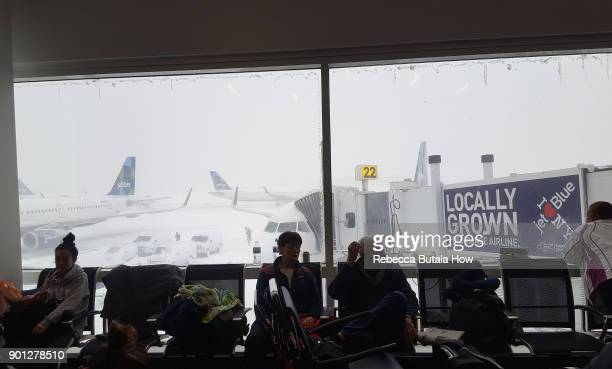 Passengers wait for delayed flights at their gate in terminal five at John F Kennedy International Airport on January 4 2018 in the Queens borough of...