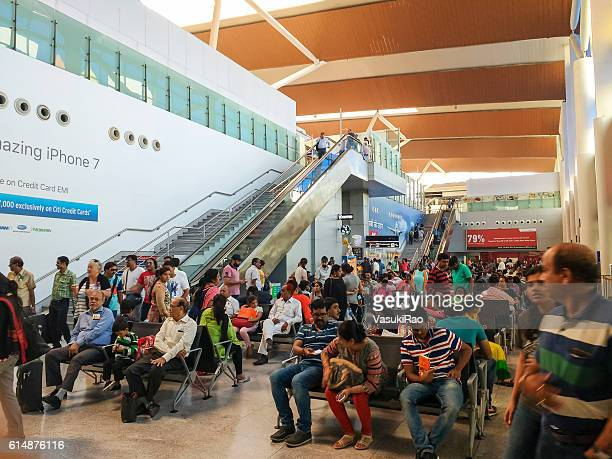 passengers wait for flights at delhi airport, india - delhi airport stock photos and pictures