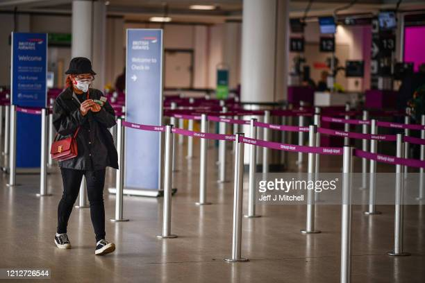 Passengers wait for flights at Edinburgh Airport on March 16 2020 in EdinburghScotlandTravel restrictions and a slump in demand for flights as a...