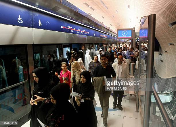 Passengers wait for the first metro ride at a station in Dubai following the official opening of the Gulf emirate's metro network on September 9 2009...