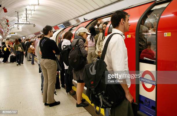 Passengers wait for the next underground train to come in the hope that it is less busy during rush hour on August 29 2008 in London England Many...