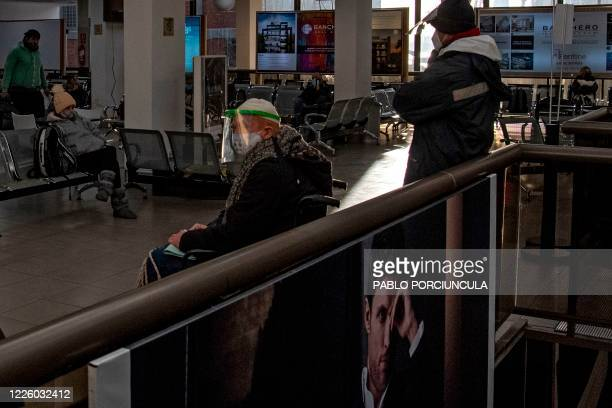 Passengers wait for the result of their COVID19 test at Argentinian ferry service company Buquebus' terminal in the port of Montevideo on July 10...