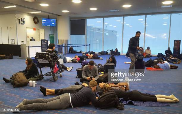 Passengers wait for their delayed flights at gate 15 in terminal five at John F Kennedy International Airport on January 4 2018 in the Queens borough...