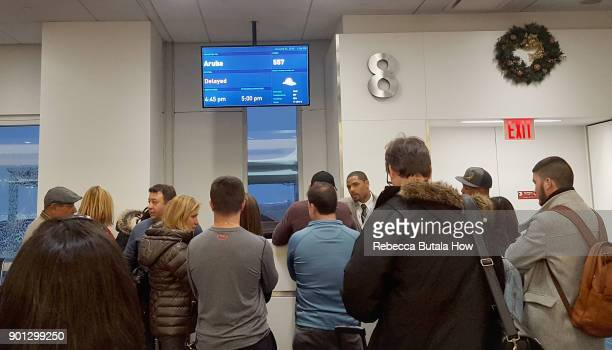 Passengers wait for their delayed flights at gate 8 in terminal five at John F Kennedy International Airport on January 4 2018 in the Queens borough...