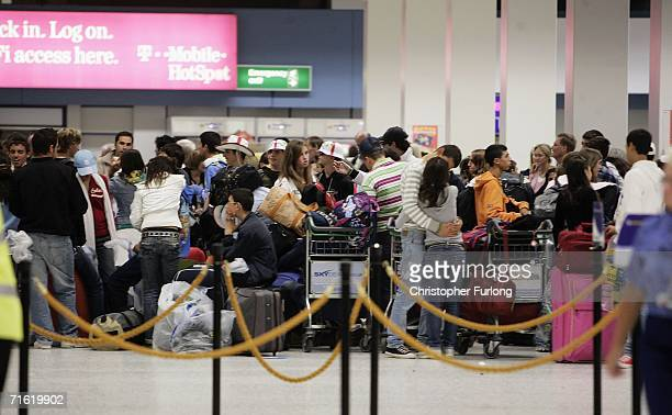 Passengers wait for their flights at Manchester Airport on August 10, 2006 in Manchester, England. British airports have been thrown into chaos as...