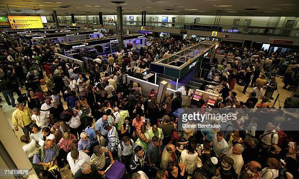 Passengers wait for their flights at Terminal One Heathrow Airport on August 10, 2006 in London, England. London Airports have been thrown into chaos...