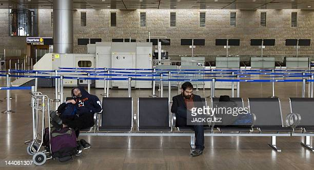 Passengers wait for their flights during a sixhour strike at the Ben Gurion Airport near Tel Aviv on February 8 2012 Half a million Israeli public...