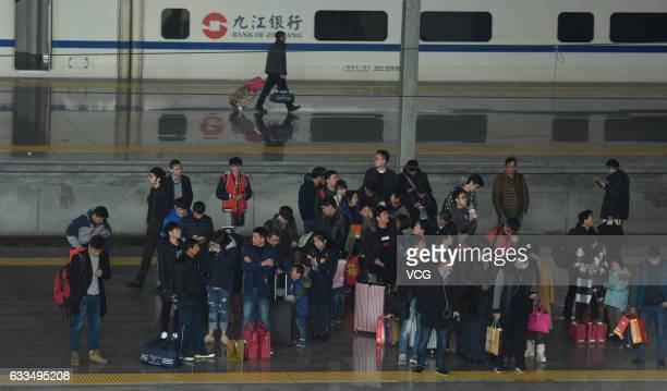 Passengers wait for their trains at Hangzhou Railway Station on February 2 2017 in Hangzhou Zhejiang Province of China This is the peak travel time...