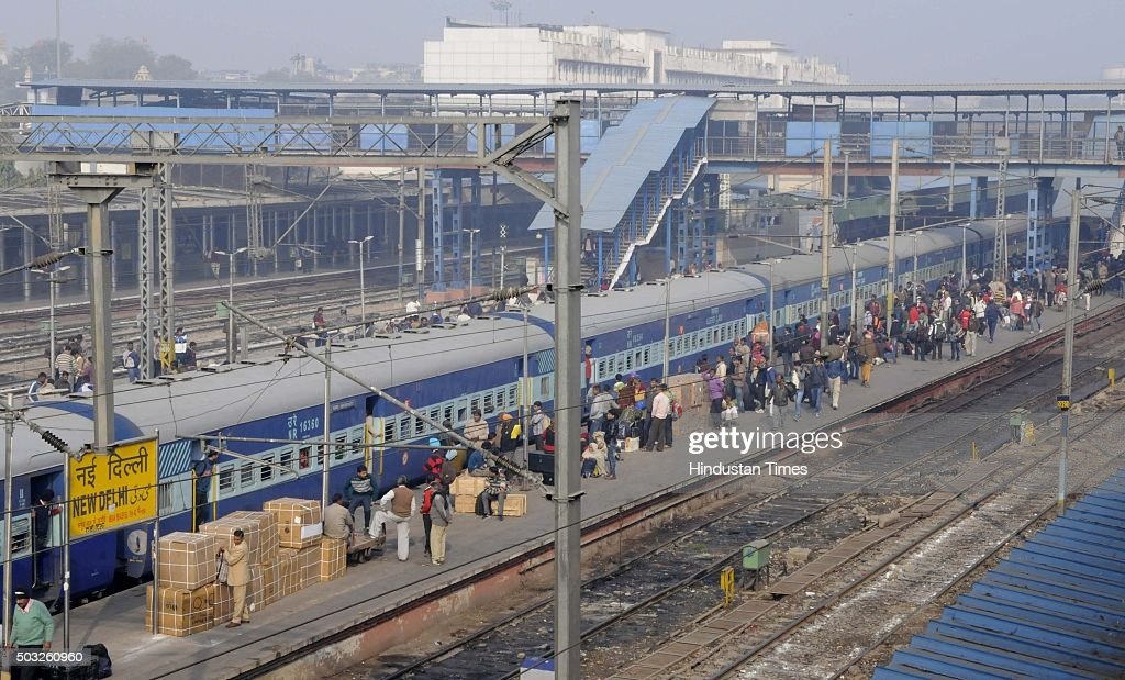 Passengers wait for their trains to arrive at the New Delhi Railway Station as security across the capital was beefed up after authorities received a.