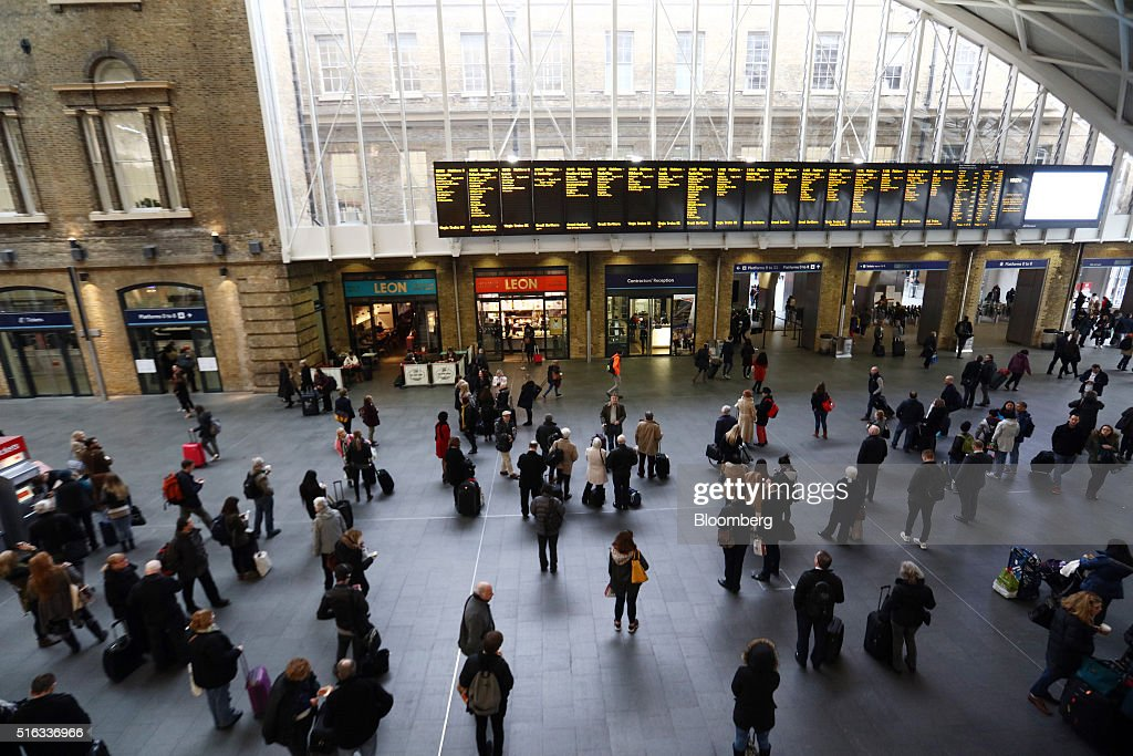 Passengers wait for trains on the concourse at Kings Cross station, in London, U.K., on Friday, March 18, 2016. Virgin Trains will revive plans to offer high-speed Internet access on Europes busiest rail route in a bid to beat the plane and persuade business people to travel outside peak hours. Photographer: Chris Ratcliffe/Bloomberg via Getty Images