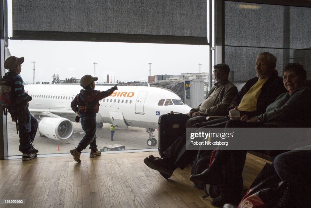 Passengers wait in a departure lounge at the Oslo Airport Gardermoen March 9, 2013 in Oslo, Norway. Gardermoen is the main domestic hub and international airport for Norway.
