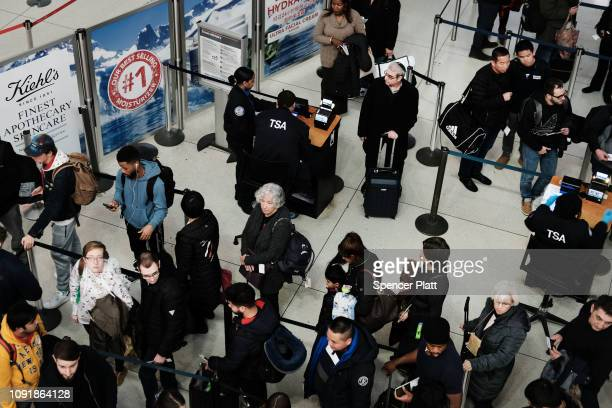 Passengers wait in a Transportation Security Administration line at JFK airport on January 09 2019 in New York City Its been reported that hundreds...