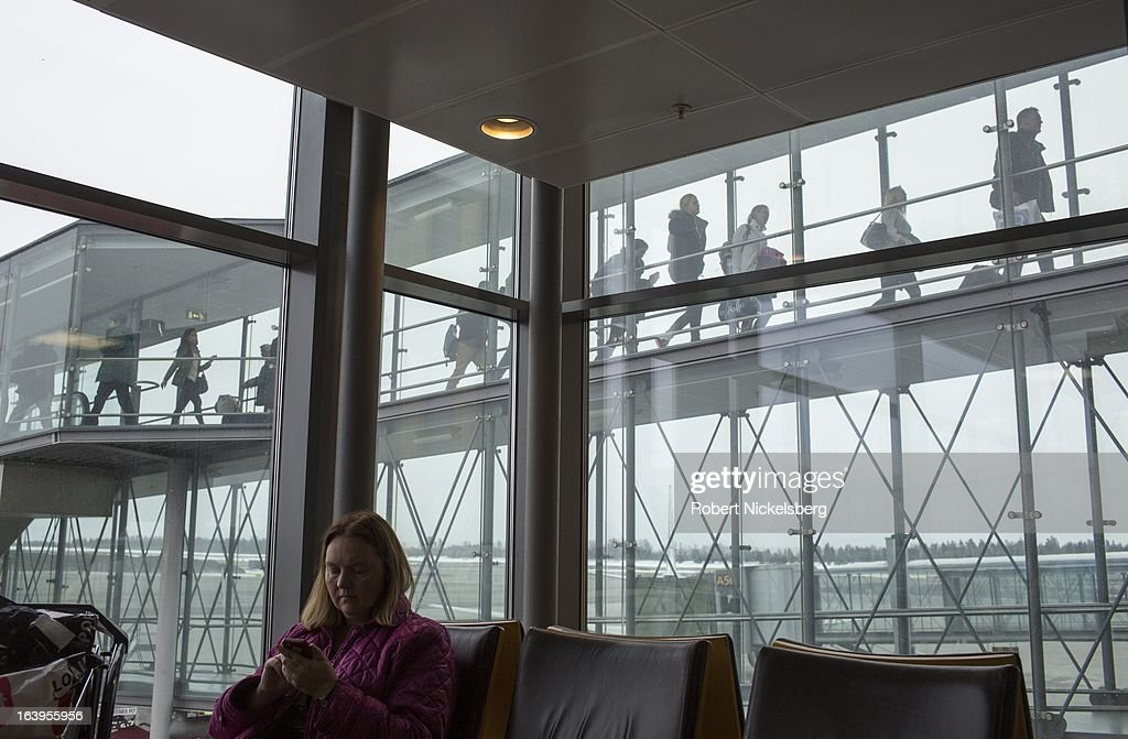 Passengers wait in a United Airlines departure lounge at the Oslo Airport Gardermoen March 9, 2013 in Oslo, Norway. Gardermoen is the main domestic hub and international airport for Norway.