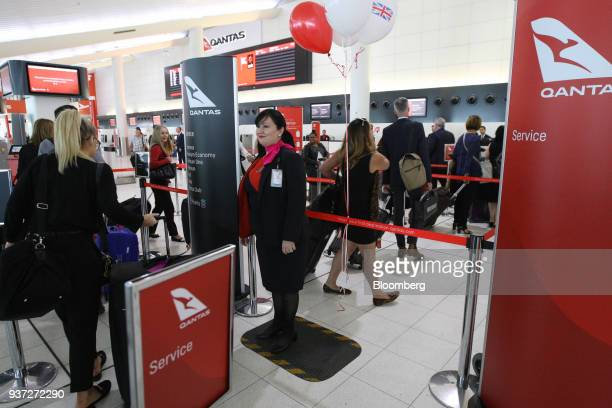 Passengers wait in line at checkin counters for Qantas Airways Ltd's inaugural flight to London at Perth Airport during a media event in Perth...