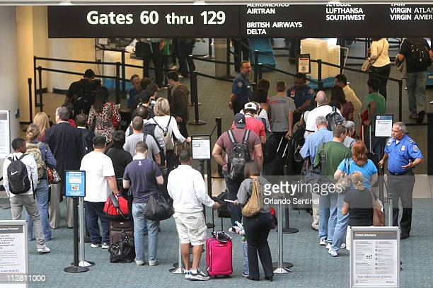 Passengers wait in line at the Bside security checkpoint at Orlando International Airport Wednesday November 24 2010 Although the day before...