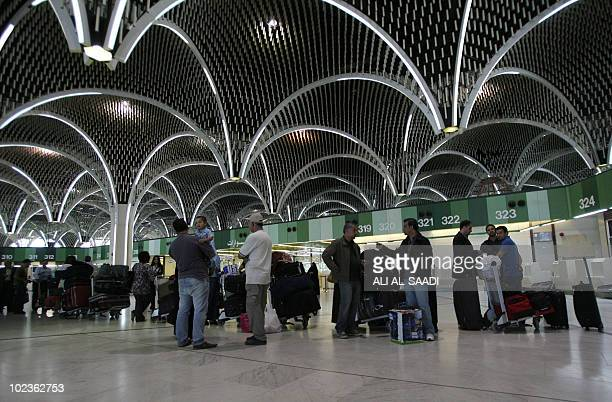 Passengers wait in line to check in at Baghdad International Airport on April 24 2010 More than a decade of UN sanctions followed Saddam Hussein's...
