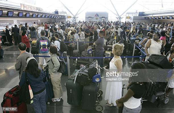 Passengers wait in line to check in at the American Airlines terminal at JFK International Airport August 10 2006 in the Queens borough of New York...