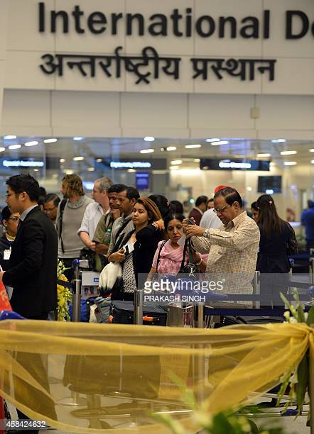 Passengers wait in line to check in at the departure hall at Terminal 3 of Indira Gandhi International airport in New Delhi on November 5 2014 AFP...