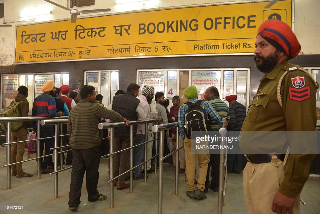 Passengers wait in line to purchase train tickets at a railway station in Amritsar on February 26 2015 India said it would spend 137 billion dollars..