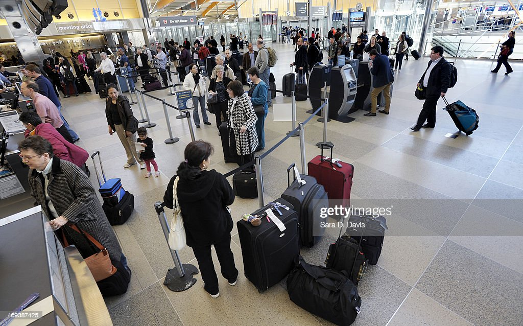 Passengers wait in longs lines for the US Airways ticketing counter at the Raleigh-Durham International Airport on February 14, 2014 in Morrisville, North Carolina. Passengers reported waiting over an hour in lines for the ticketing counters. RDU canceled flights starting Wednesday afternoon through Thursday as a winter storm crippled the region.
